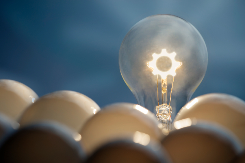 Solution and communication business concepts. Idea symbol, light bulb, gear inside light blob.